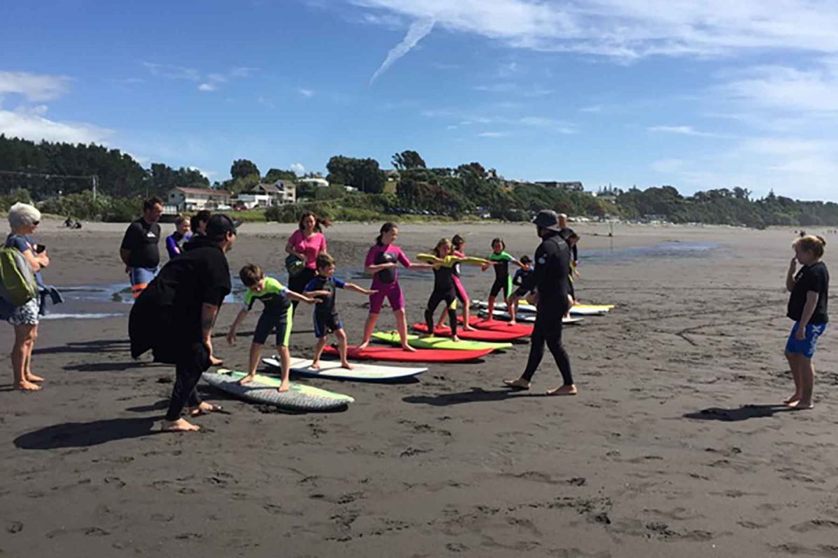 The Vertigo team running surf lessons at Oakura beach